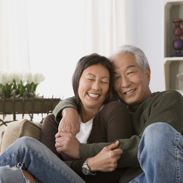 """Older couple in warm embrace"" stock image"