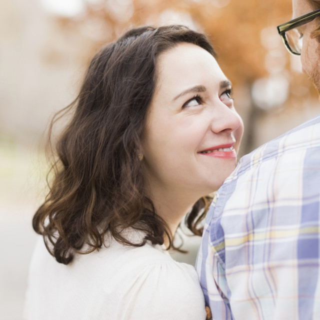 """Smiling couple looking at each other"" stock image"