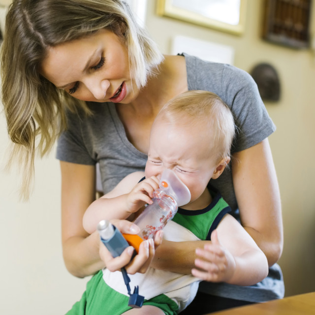 """""""Mother inhaling son (12-17 months)"""" stock image"""