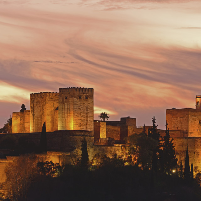 """""""Illuminated castle at dusk, pastel colored clouds in sky"""" stock image"""