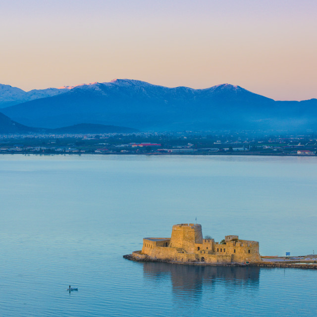 """""""The Venetian Bourtzi fortress in Nafplio bay, with the Peloponnese mountains..."""" stock image"""