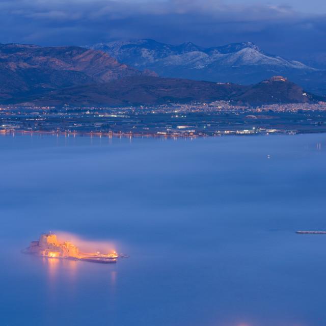 """Bourtzi fortress in morning mist, in Nafplio port, Peloponnese, Greece."" stock image"