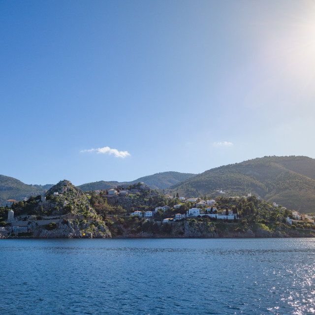 """""""Hydra Island main harbour, seen from the sea, with traditional houses and..."""" stock image"""
