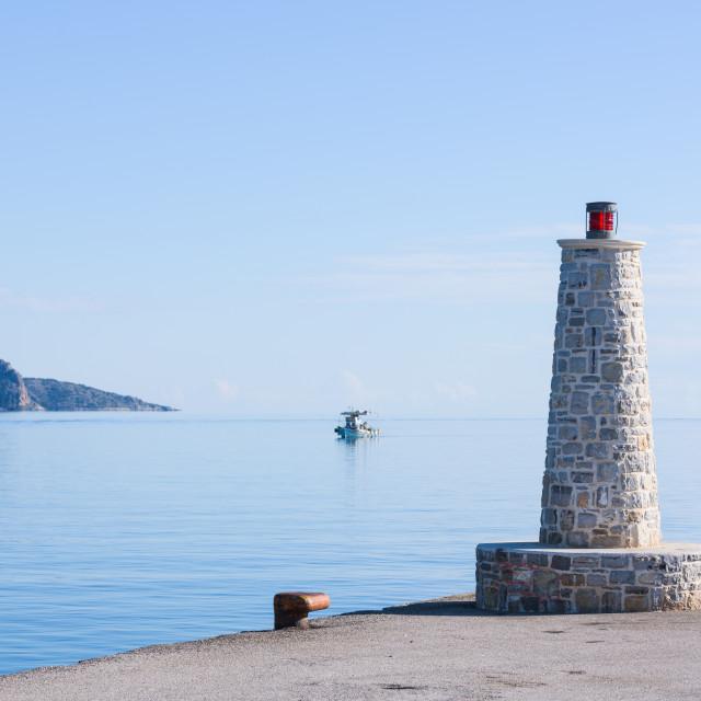 """Beacon light with stone base, in Ermioni port near Nafplio, Greece."" stock image"