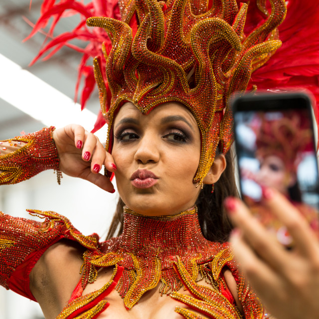 """""""Brazilian woman taking selfie photo for the carnival party"""" stock image"""
