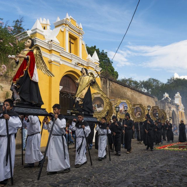 """Antigua, Guatemala - April 19, 2014: Men carrying parade floats in a street of the old city of Antigua during a procession of the Holy Week, in Antigua, Guatemala"" stock image"