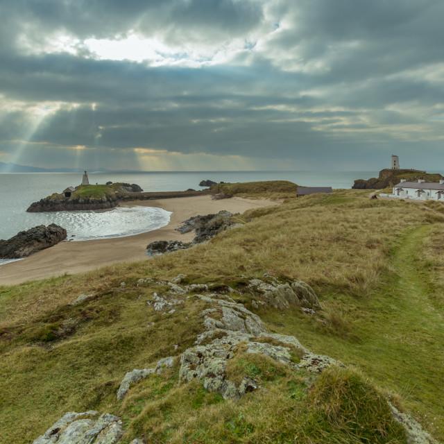 """Sunbeams at Llanddwyn Island on Anglesey"" stock image"