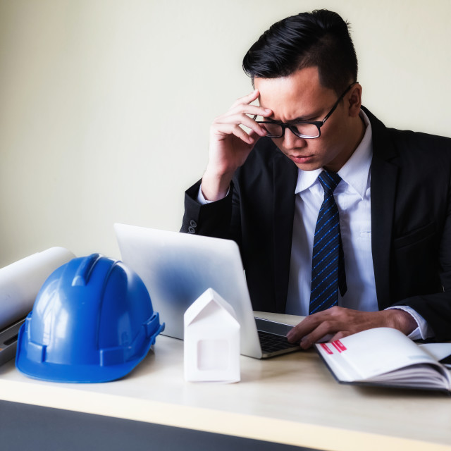 """""""Stressed businessman look at PC for project plan"""" stock image"""