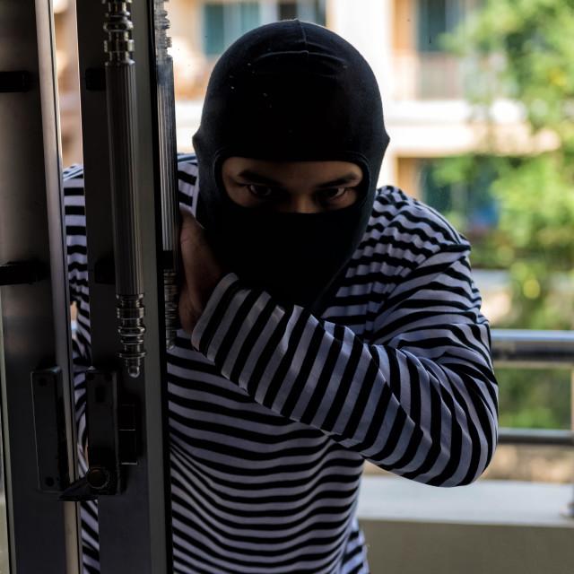 """""""thief break condo balcony door"""" stock image"""