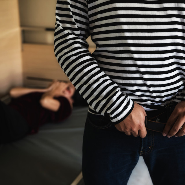 """""""Man wear belt and jeans after raping"""" stock image"""