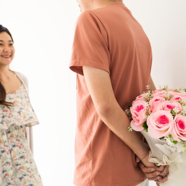 """Man hand hiding flower bouquet"" stock image"