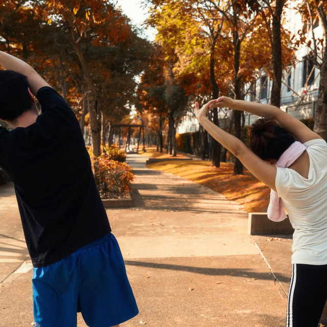 """""""couple exercising in autumn park"""" stock image"""