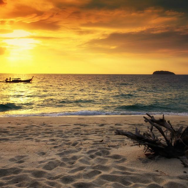 """Silhouette sailing fishing boat at sunrise"" stock image"
