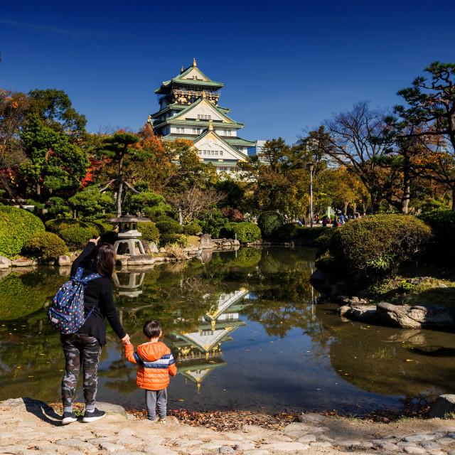 """Family visit Osaka castle at fall, Japan"" stock image"