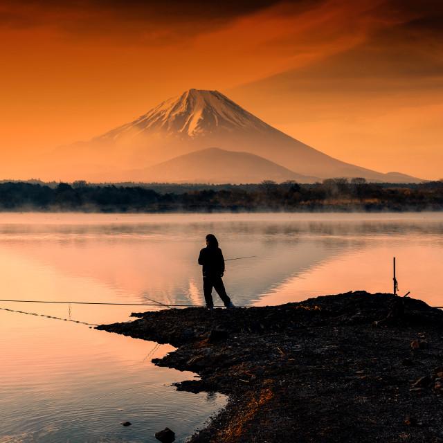 """fishing at Lake against mt. fuji at dawn"" stock image"