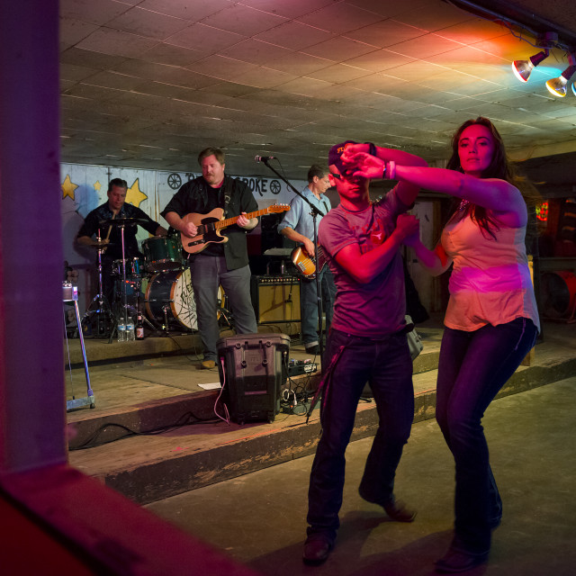 """Austin, Texas - June 13, 2014: Country music band playing and people dancing in the Broken Spoke dance hall in Austin, Texas, USA"" stock image"