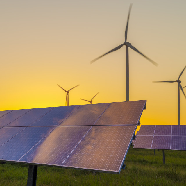 """Wind generators turbines and solar panels on sunset"" stock image"