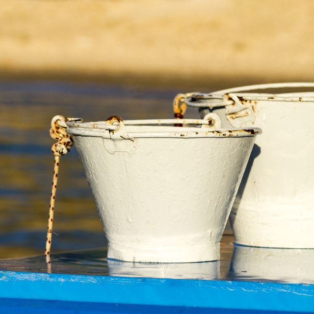 """""""White buckets on blue table"""" stock image"""