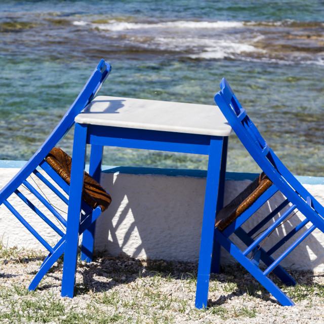 """""""Blue painted chairs and table"""" stock image"""