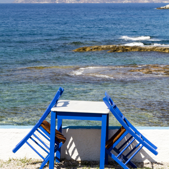 """""""Painted chairs and table by the sea"""" stock image"""