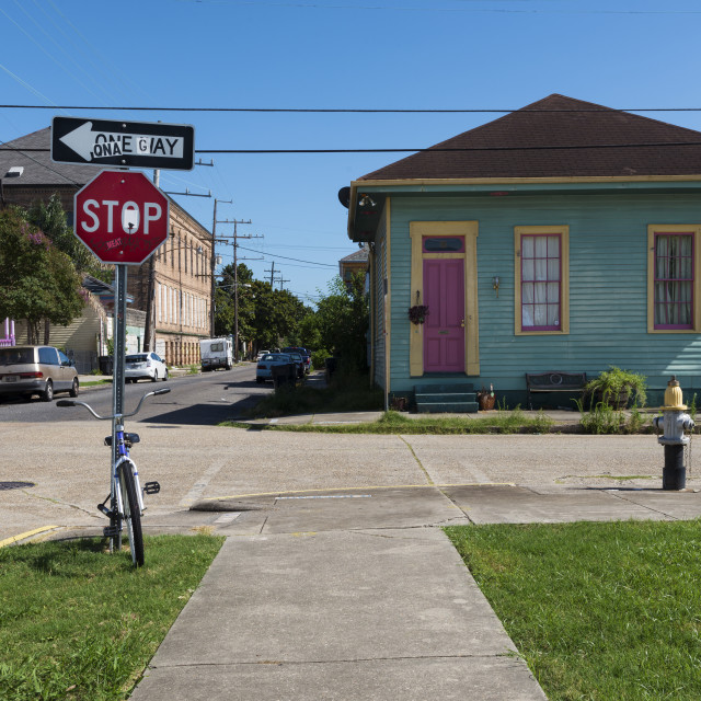 """New Orleans, Louisiana - June 17, 2014: View of a street with colorful houses in the Marigny neighborhood in the city of New Orleans, Louisiana, USA"" stock image"