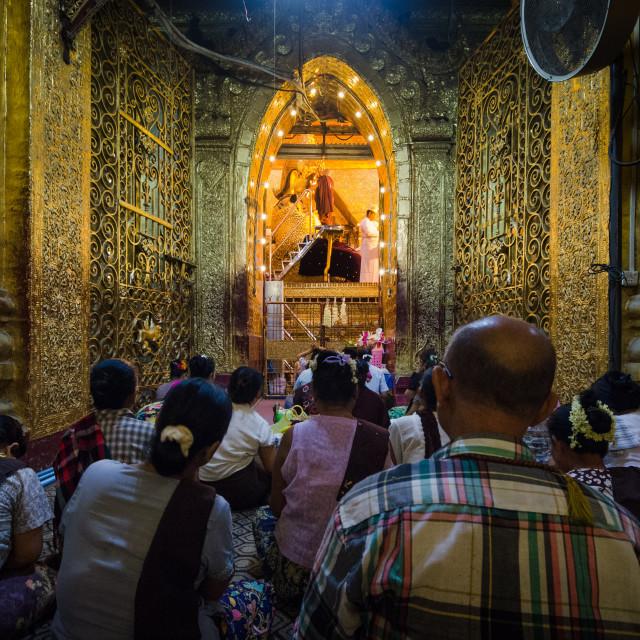 """The Buddha face washing ceremony, at dawn, in Mahamuni Phaya, Mandalay"" stock image"
