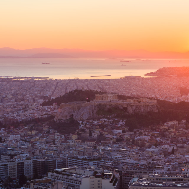 """""""Colorful sunset over Athens, with Acropolis, modern city and Mediterranean..."""" stock image"""