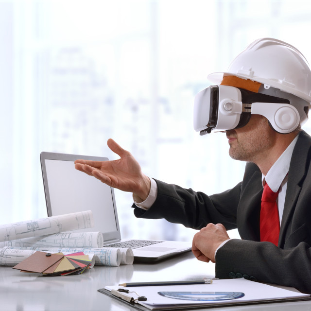 """""""Architect interacting with 3d content in virtual reality glasses"""" stock image"""