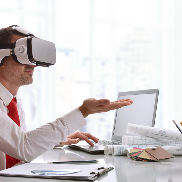 """""""Designer interacting with 3d content in virtual reality glasses"""" stock image"""