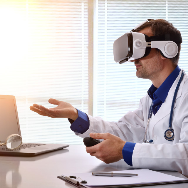 """""""Doctor interacting with 3d content with virtual glasses in office"""" stock image"""