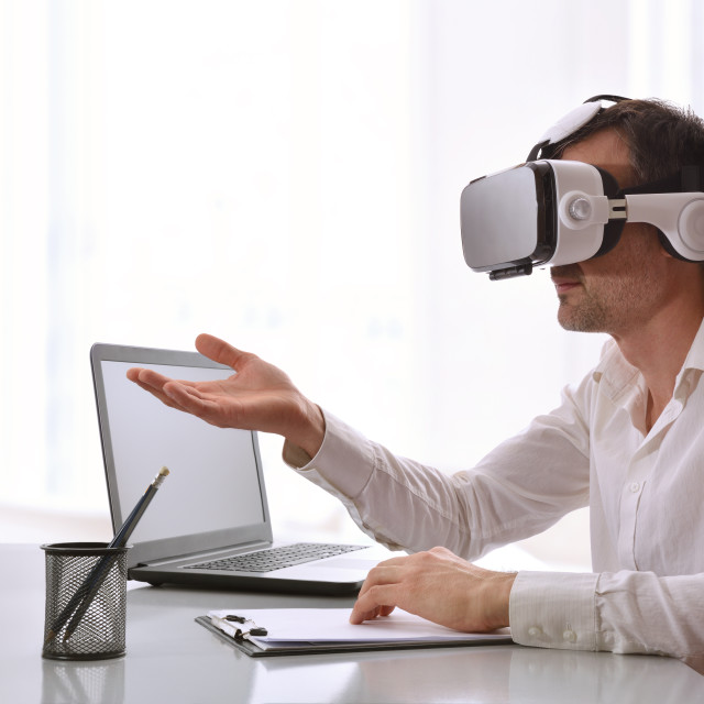 """""""Worker interacting with with 3d projection in office"""" stock image"""