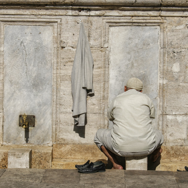 """Turkish man washing feet near mosque"" stock image"