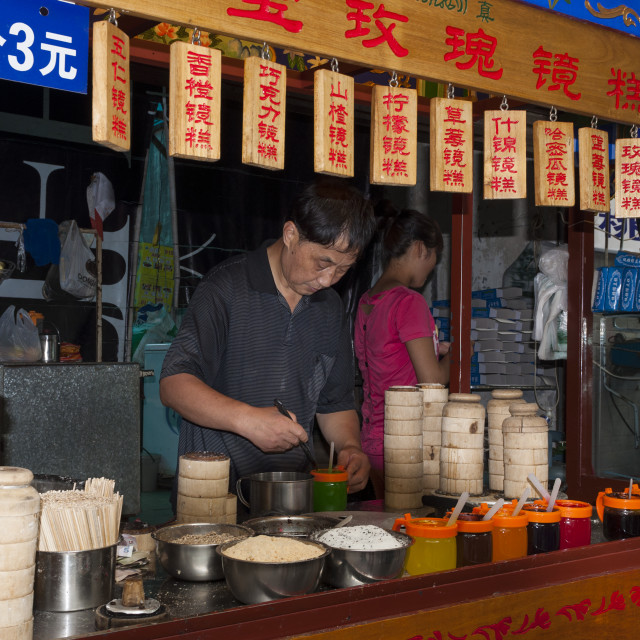 """Xian, China - August 5, 2012: A food stall in a street of the Muslim Quarter in the city of Xian in China, Asia"" stock image"