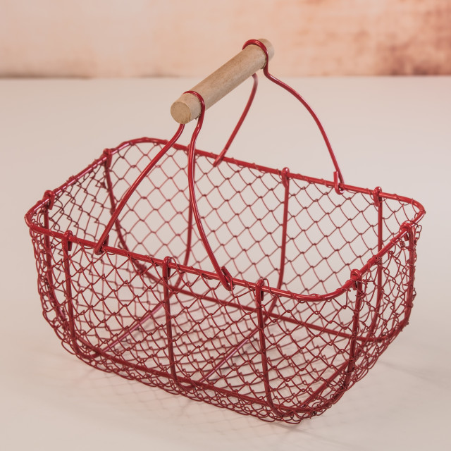 """Red wire basket on white background"" stock image"
