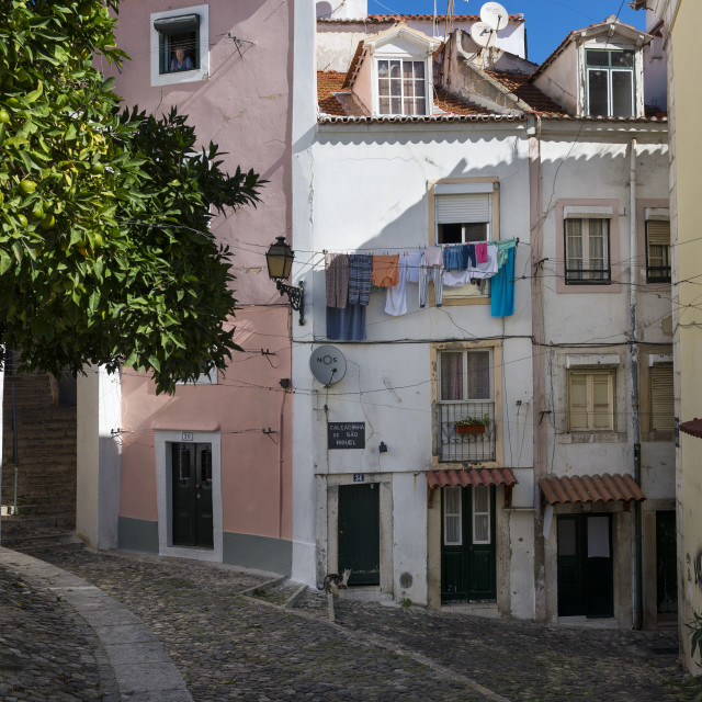 """Lisbon, Portugal - October 22, 2017: View of traditional old buildings in the historic neighborhood of Alfama in Lisbon, Portugal"" stock image"