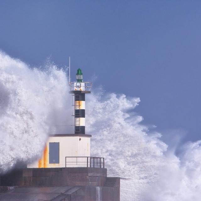 """Stormy wave over lighthouse of San Esteban de Pravia."" stock image"