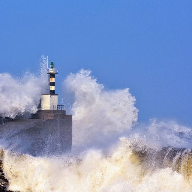 """Stormy wave over lighthouse of San Esteban de Pravia."" stock image"