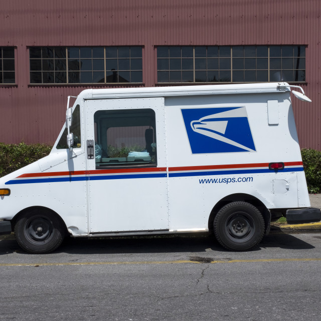 """New Orleans, Louisiana - June 17, 2014: United States Postal Service (USPS) truck parked in a street of the city of New Orleans in Louisiana, USA."" stock image"