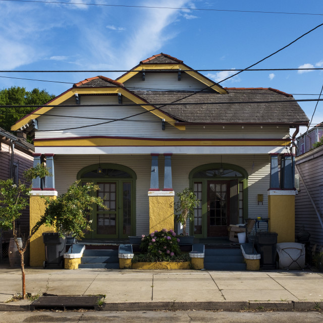 """The facade of a traditional colorful house in the Marigny neighborhood in the city of New Orleans, Louisiana, USA"" stock image"