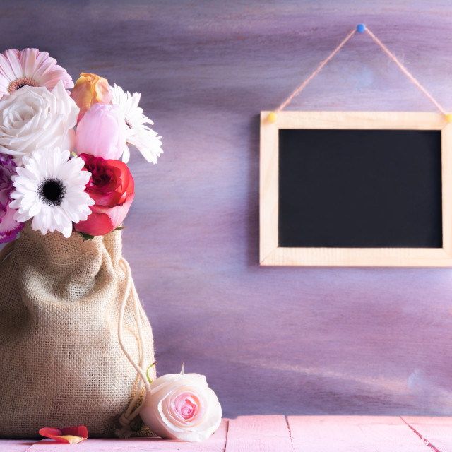 """""""Flower bouquet in a jute sack and a chalkboard"""" stock image"""