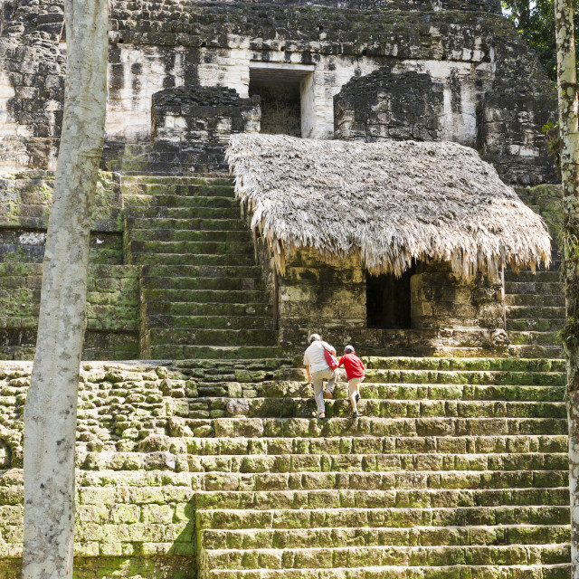 """Tourists At Temple Ruins In Tikal"" stock image"
