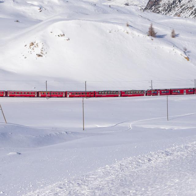 """Bernina red train in snowy landscape"" stock image"