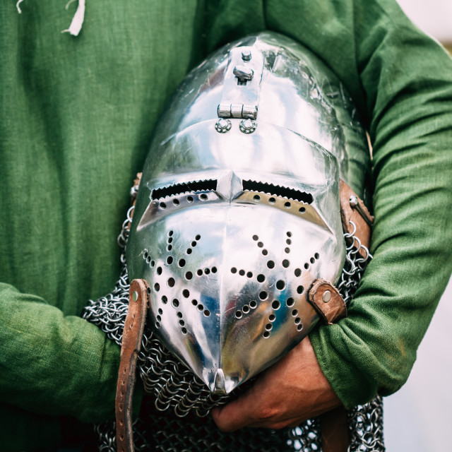 """Knight Helmet Of Medieval Suit Of Armour On Table"" stock image"