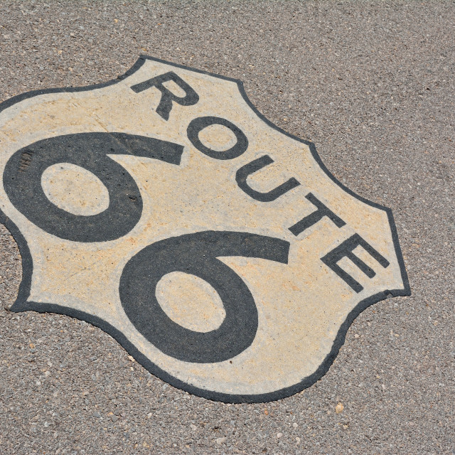 """Route 66 sign in asphalt, USA."" stock image"