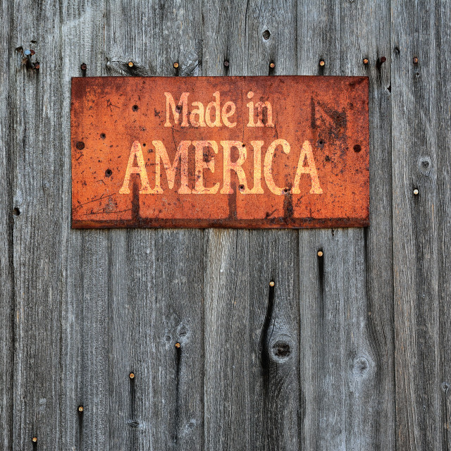 """Rusty metal sign with the phrase: Made in America."" stock image"
