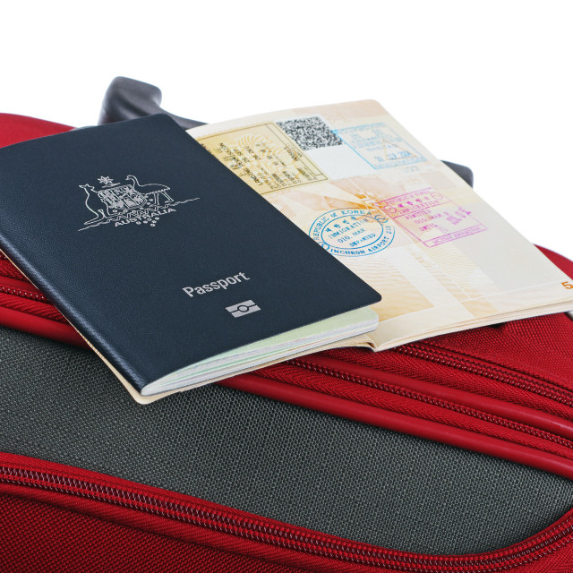 """red travel case and passport"" stock image"