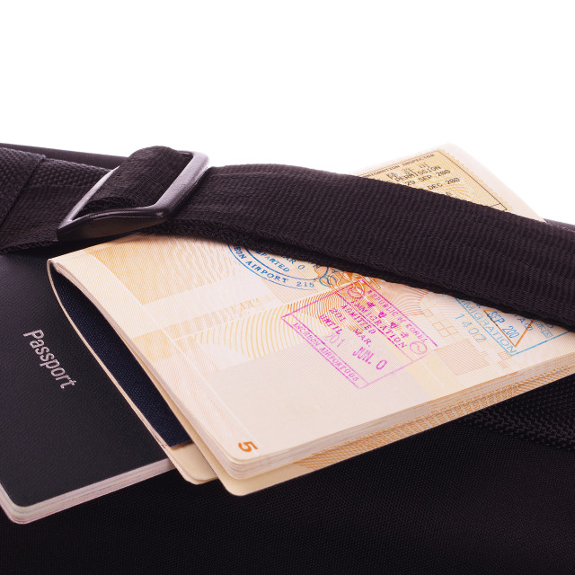 """black travel bag and passports"" stock image"