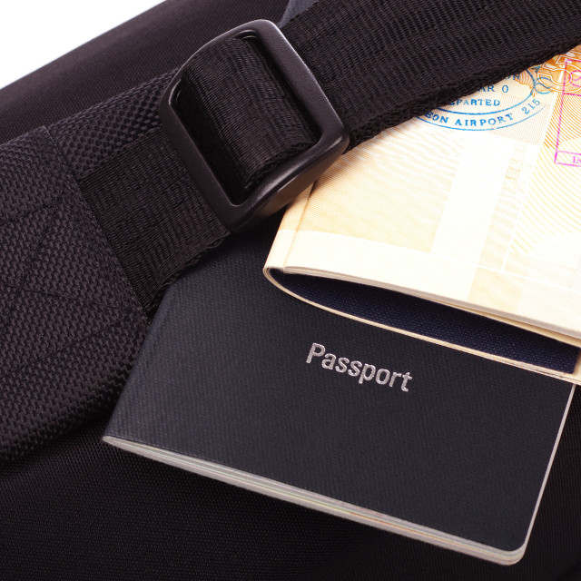 """passports on top of a black bag"" stock image"