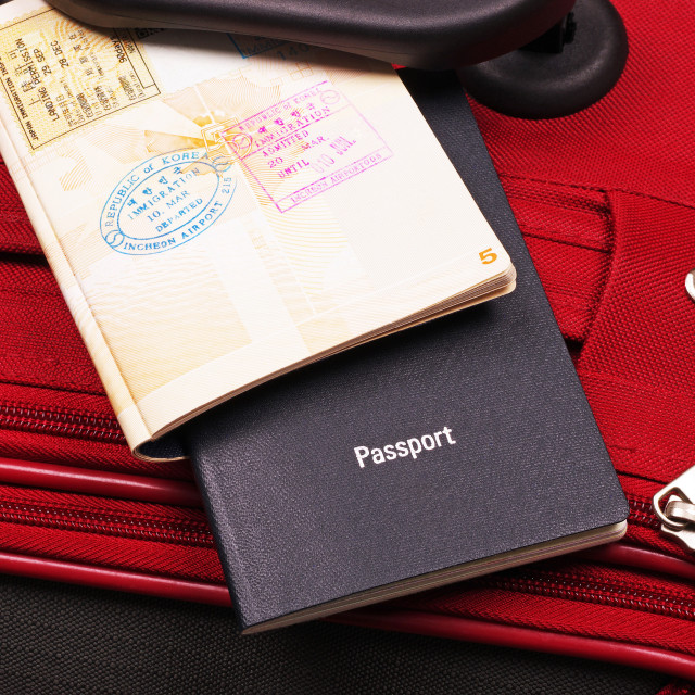 """two passports on a red travel case"" stock image"