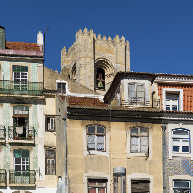 """""""Detail of the facade of traditional buildings with the bell tower of the Lisbon Cathedral on the background in Lisbon, Portugal; Concept for visit Lisbon."""" stock image"""